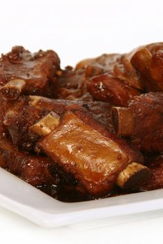 These short ribs are just what the doctor ordered! Meaty ribs braised in Dr. Pepper with ketchup, vinegar, and Worcestershire for a meal with some real pop to it. Pork Short Ribs, Braised Short Ribs, Beef Ribs, Pork Rib Recipes, Meat Recipes, Cooking Recipes, Meat Meals, Smoker Recipes, Top Recipes