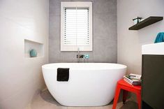 White round free standing bathtub with chrome tap and mixer. Black vanity with white basin top and black shelf. Project by - @embracingspace #taps #interiordesign #bathroom #australia #architecture #bathroomdesign #bathroomcollective Visit our website for more www.bathroomcollective.com.au