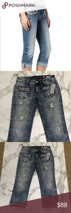 NWT Miss me mid rise Capri acid wash Perfect condition comes with all the tags size 27. Distressed acid wash. Blushed toned jewels in pockets Miss Me Jeans Ankle & Cropped