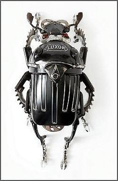 Edouard Martinet  Egyptian Beetle  Abdomen: Headlight taken from a car driven during the Second World War   Thorax: Luxor headlight used for a motorbike   Wings: Hood ornament of a Citroen   Hed, legs and antennae: Bike parts