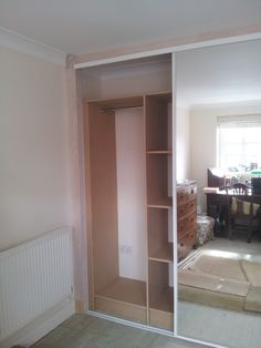 Sliding mirror doors within studwork frame with MDF fitted interior