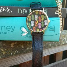 ☆HP☆ Pineapple Print Black Leather Watch Olivia Pratt 13620 Pineapple Pop Print Black/Multi Leather Watch      A printed dial pops on this oversize leather design.     Movement: Chinese Quartz     Case diameter: 41mm     Bezel function: Stationary     Clasp: Buckle     Band width: 19mm     Dial window material type: Mineral-Coated Glass Olivia Pratt Accessories Watches