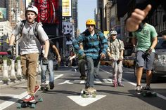 Skateboarders pass Times Square while they take part in a race on the streets in New York, October 20, 2012. REUTERS/Eduardo Munoz