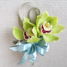 Nice corsage of green mini cymbidiums