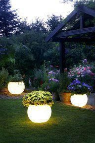 Another cool idea using Rustoleums Glow in the Dark paint . . paint it on pots and set them around the deck or pool .. they absorb sunlight during the day and glow at night .. love this!