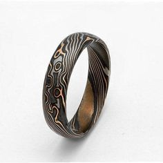 Beautiful and unique Mokume Gane rings. 14K Palladium white gold ,14 k Rose gold and sterling silver band. Made to order. Handmade gorgeous unique Gold and Sterling Silver Mokume Gane wedding bands. Japanese technique that looks like woodgrain. Mixed metal. The rings are solid