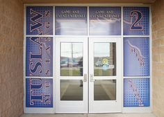 Custom designed, printed & installed perforated window mural for the entrance doors into Tuslaw High School  - Tuslaw, OH