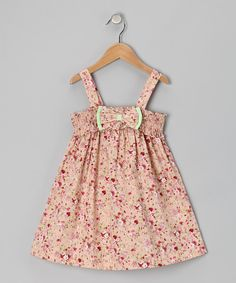 This pretty dress shows off smocking, a pull-on style and a big bow to finish it off. The look is classic, charming and cute as a button.100% cottonMachine washMade in Vietnam