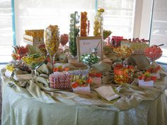 An Affaire of the Heart provided and customized this citrus themed candy bar station for a Wedding Reception. These can also be great for any party!