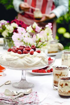 Impress your summertime dinner guests with this delicious Rosewater Pavlova dessert recipe - simple, delicious and a real crowd pleaser!