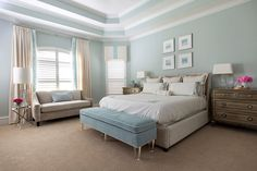 A master bedroom by Amanda Carol Interiors with aqua blue painted walls.- Pinned by #AngelicaAngeli - angelicaangeli.com