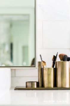 Antique brass makeup brush holder that's pretty enough to display on the bathroom counter! Rural Chic – Alice Lane Home Interior Design