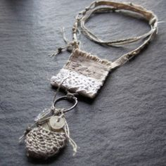 fragile strength talisman pouch/be still - mary jane dodd - the ability to manifest moments of quietude and solitude can only be learned by the individual, but throughout the eons it has been a goal sought by many and creates a connection to the ancients... this piece incorporates rare and ancient beads into a new work, making the desire to reach back in time possible.