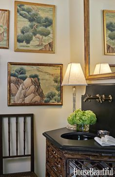 Framed fragments of Gracie's Georgian Tea Trade wallpaper have the impact of landscape paintings in a South Carolina home's powder room. The vanity is a converted antique console. Click through for more of the best bathroom design ideas.