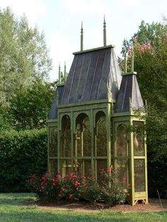 I would love to make a little greenhouse like this!  Love the Gothic details and the tin roof! ♥