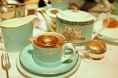 Tea at Fortnum and Mason, and their trademark aqua color. Elegance.