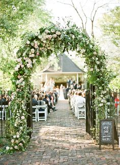 rose arbor for the wedding ceremony | Mandy Busby