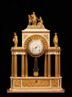 Exceptionally large and fine Louis XVI bronze doré and marble mantel portico clock in the form of a triumphal arch honoring the founder of the Bourbon dynasty in France, Henri IV. The base is decorated with a central ormoulu plaque portraying children and putti personifying the arts; one points to a stone carved with the opening lines of Voltaire's Épître 96, a poem extolling Henry IV - Dim: H: 43 (109 cm), W: 28.5 (72.4 cm), D: 5.5 (14.5cm).