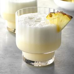 A velvety-smooth texture and taste of the tropics are what this pina colada delivers. The easy-to-make drink can be mixed and chilled ahead of time. When ready to serve, just blend for a creamy and delicious beverage. Alcohol Drink Recipes, Martini Recipes, Refreshing Cocktails, Yummy Drinks, Easy Mixed Drinks, How To Make Drinks, Thing 1, Coconut Recipes, Smoothies