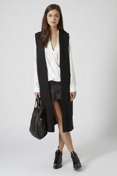Black sleeveless coat via #topshop