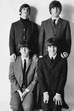 Beatles ____ Paul with the LONG long legs, looks short here in front of Ringo . . . and he don't look too happy about it.