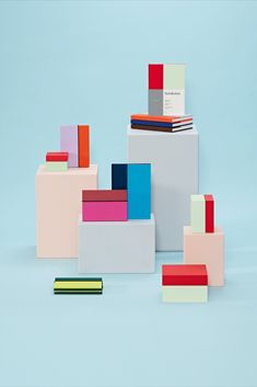 """How do you find a new idea for paper products in the ever-evolving digital world? We take a stroll through our bookshelf! Based on the bookbinding practice of half-linen or half-leather binding, we developed a contemporary and sleek product line for the brand Semikolon over the last 2 years. Divided in a """"golden ratio"""" and wrapped in a fresh two-tone color scheme, it presents notebooks, photo albums and boxes for storing those things closest to your heart."""