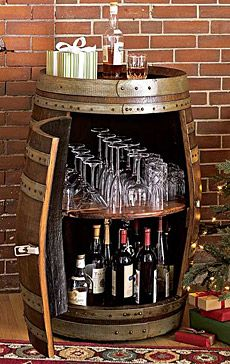 An old wine barrel as bar and wine set! Easy and simple access with hinged door on the side and pouring station atop! sweet.