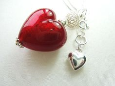 A red Murano glass heart pendant with sterling by artbypolli
