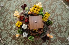 billy buttons/craspedia/billy balls in sculptural tablescapes that remind me of bento boxes