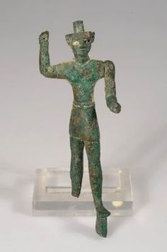 Statue of the storm god poised to strike Hazor Late Canaanite period, 15th-13th century BCE Bronze H: 15; W: 5.5; D: 5 cm Israel Antiquities Authority