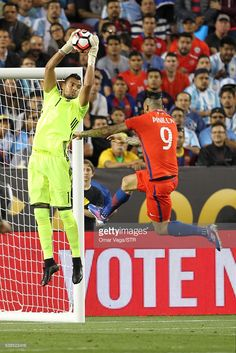 Sergio Romero goalkeeper of Argentina and Mauricio Pinilla of Chile jump for the ball during a group D match between Argentina and Chile at Levi's Stadium as part of Copa America Centenario US 2016 on June 06, 2016 in Santa Clara, California, US.
