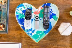 The coffee table, a piece from World Market, is covered in colorful books and accessories. This heart tray from Oh Joy for Target is perfect for remotes. World Market, Life Is Beautiful, Beautiful Shoes, Home Living Room, Retro, House Tours, Sweet Home, Nursery, Joy