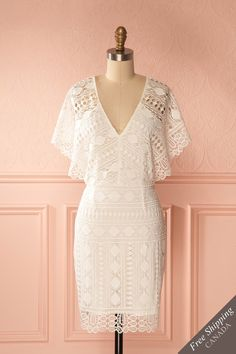 Tamika #Boutique1861 / This romantic crocheted lace dress will bring a bohemian quality to your special day. Short and fitted, this classic cut is made a little more free spirited with the see-through batwing sleeves. Whether you wear it for the ceremony or simply for the celebration afterwards, you'll look and feel fabulous.