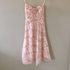J.Crew Strapless Blush Flora Dress Perfect for summer events.  Strapless blush flora print dress. Zips up the back and ruched at the bust with a tie in the middle. Boning at the sides for structure and lined for extra coverage.  Hits right above the knee. Great condition. J. Crew Dresses Strapless