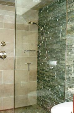 another view of the stacked stone walls into the shower & porcelain wall tile