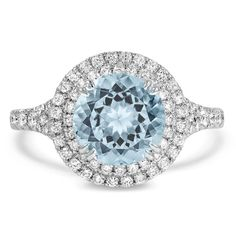 A total showstopper, this glamorous modern reproduction white gold engagement ring features a dazzling round aquamarine in a double halo of diamonds. Available in White Gold. Vintage Diamond Rings, Round Diamond Ring, Diamond Gemstone, Vintage Rings, Gemstone Rings, Traditional Engagement Rings, Modern Engagement Rings, Perfect Engagement Ring, Engagement Ring Buying Guide