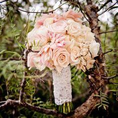 Sahara roses, dahlias and gardenias wrapped in lace