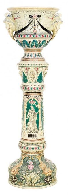 pedestal with integrated jardiniere in the Majolica style. The pedestal comprised of three separate pieces, together with the matching jardiniere, are bolted together to create a single unit. A profusion of Victorian ornamentation, including sea creatures, scallop shells, starfish and aquatic plants, together with classical Renaissance maidens and knights.