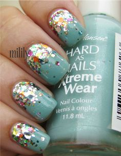 ombre sparkle nail polish. would love to do this to my nails but with different colors.