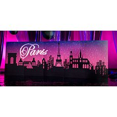 Our Paris Night Background displays the night skyline of Paris complete with the Eiffel Tower.