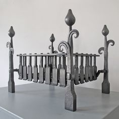 Allium fire baskets and firedogs hand forged by sussex blacksmith and designer James Price. Decorative wrought iron inspired by english cottage gardens.