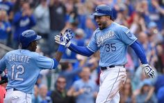 Kansas City Royals' Eric Hosmer (35) celebrates with Orlando Calixte (12) after Hosmer scored on a two run double by Kendrys Morales in the eight inning during Sunday's baseball game against the Oakland Athletics on April 19, 2015 at Kauffman Stadium in Kansas City, Mo.