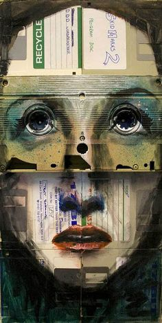 """The reproduction number 2"" (2009), by Nick Gentry. Mixed paint on used computer disks and VHS tape"
