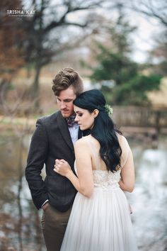Christmas Winter Barn wedding bride and groom.  We love all the lovely winter touches they used for their special day.  From vintage lounge areas with plaid to antlers and greenery to lawn games.  Photos by Trisha Kay Photography.