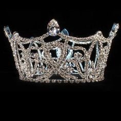 "A magnificent crown for your royal highness! This stunning silver crown is a full round design with a multitude of quality rhinestones. Measures  3"" high and 4"" wide. Perfect for pageants, Quinceanera, wedding flower girls, First Communion or any special"