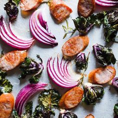 Easy, fast, & delicious. This sheet pan supper is made with the hottest new vegetable, kalettes, and roasted alongside juicy chicken sausage and red onion.