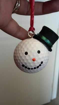 Made this for my boss out of a golf ball painted white. puff paint for the face. foam hat i made and screwed a hook on top. (took a while to screw in but no tools used) he loved it!!