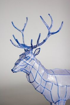Wire Sculpture of a deer covered in thin paper like tissue or vellum