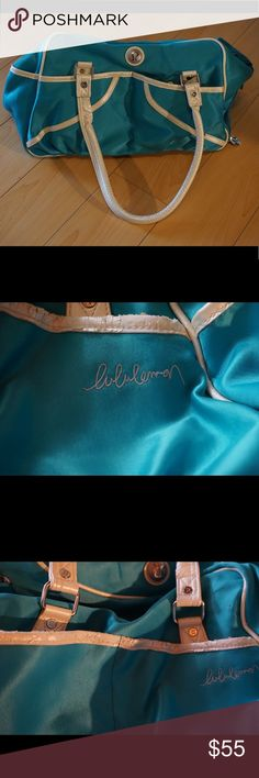 Teal Lululemon Gym Bag Cute vintage looking Lululemon Gym Bag in teal. There has been some wear and tear - I've included close up pictures of the white seams that have peeled a little. Great gym bag - has a pocket for shoes and comes with a matching gym pass holder. lululemon athletica Bags Travel Bags