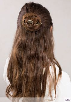 Florinda ~ beautiful antique brass floral design flexi clip with green beads, in a lovely long hair half up style.